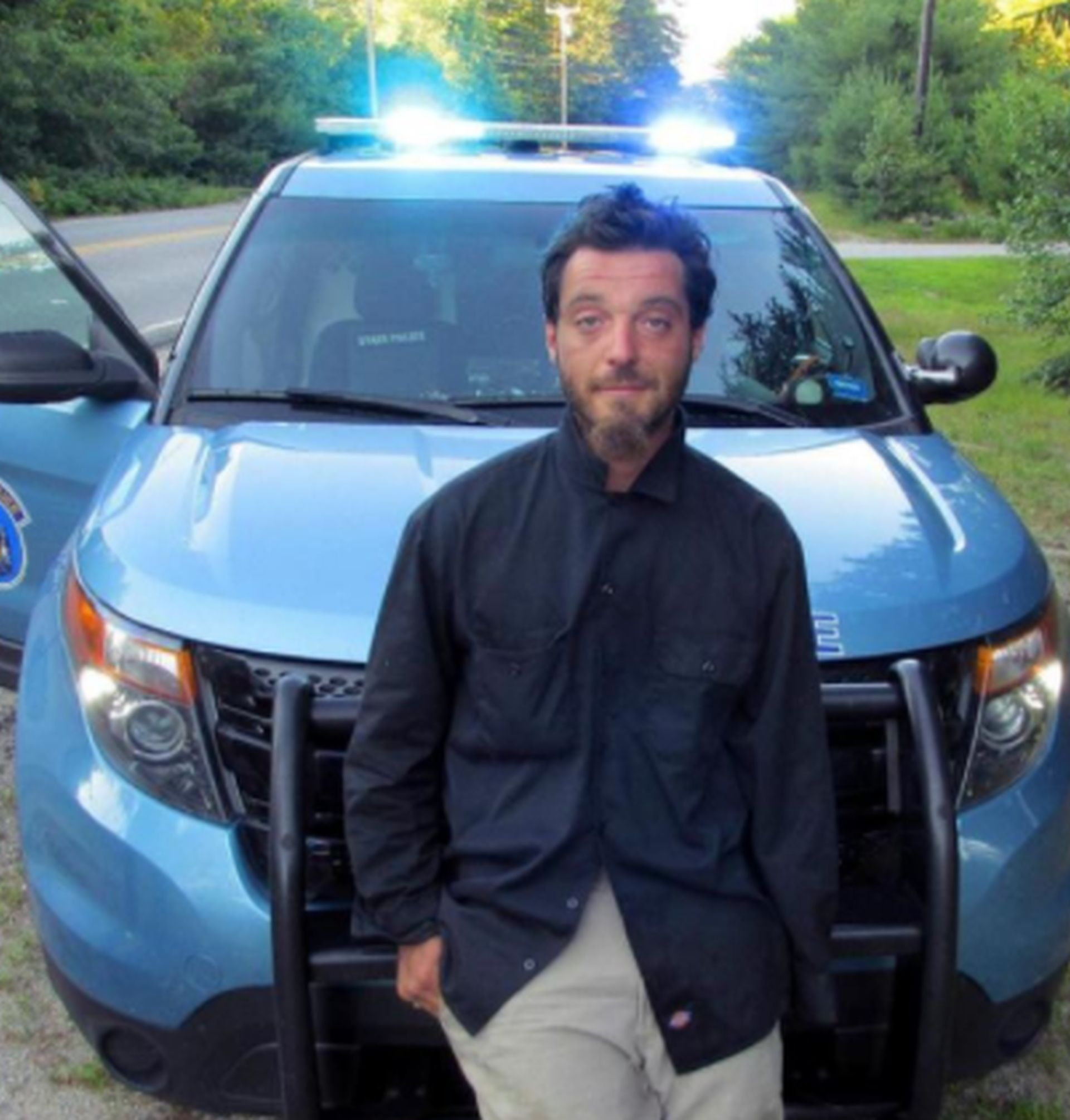 In this file photo released by the Maine State Police shows Corey Berry, of Hollis, Maine, was arrested and charged with criminal threatening after police said he was found strolling down a street wearing a clown mask with a machete taped to his amputated arm. He says it was supposed to be a prank. He pleaded not guilty Wednesday, Aug. 23, to criminal threatening and weapons charges. (Maine State Police via AP, File) THE ASSOCIATED PRESS