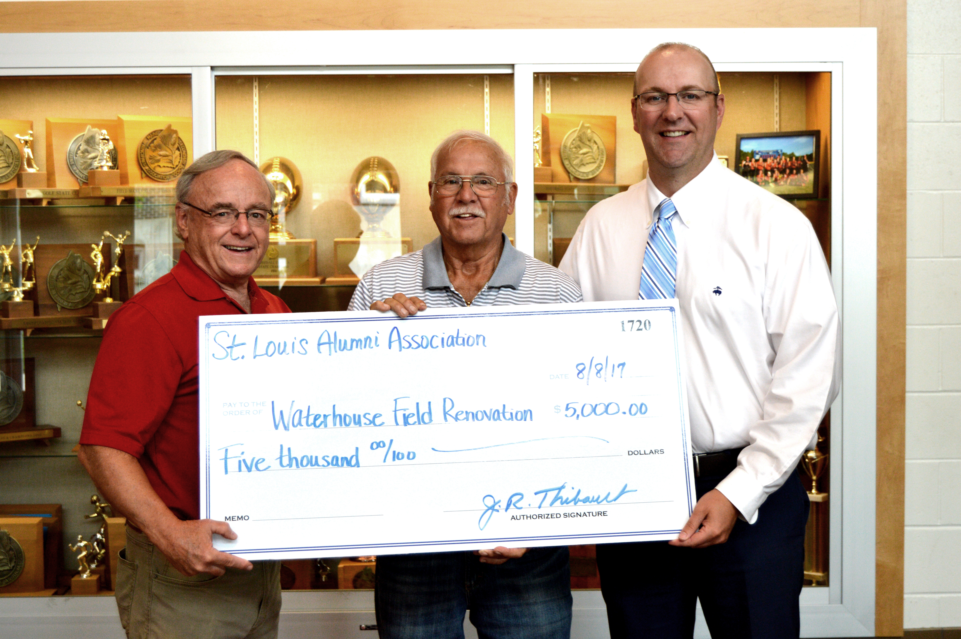 The St. Louis Alumni Association present a $5,000 check to the Biddeford School Department to support the Waterhouse Field renovations. From left are St. Louis Alumni Board of Director members John Thibault and Richard 'Dick' Dion and Biddeford Schools Superintendent Jeremy Ray. SUBMITTED PHOTO