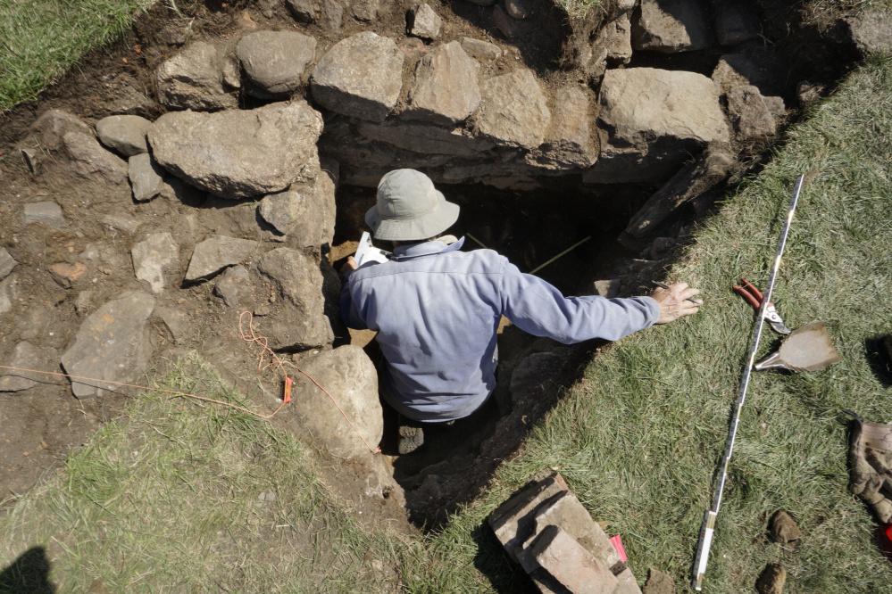 Archaeologist Kare Mathiasson records the details of a stone wall found during the dig in September 2017. One fortification built at the site, Fort William Henry, had stone walls 10 to 22 feet high.