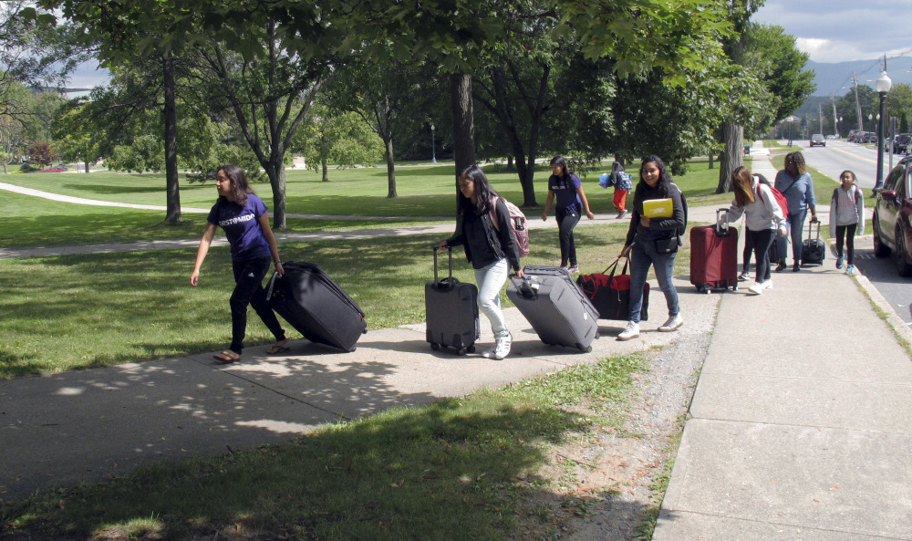First-generation students arrive at Middlebury College in Vermont late last month. The school is one of the many colleges across the country with special programs to help ease the transition for students who are the first in their families to attend college.