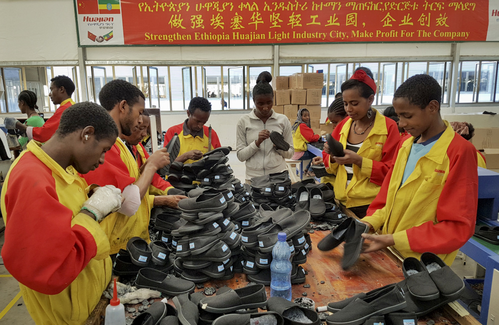 Workers sort shoes in January at a Chinese factory in Addis Ababa, Ethiopia. The Ganzhou Huajian International Shoe City Co. has been used by the Ivanka Trump  brand.