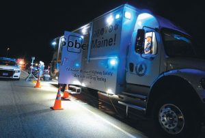 THE MAINE BUREAU of Highway Safety's mobile OUI detection vehicle is in use at a roadblock on the Route 196 Coastal Connector in Topsham on Friday.