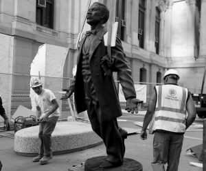 WORKERS INSTALL the statue of Octavius Valentine Catto at City Hall in Philadelphia. A century before the fight to end Jim Crow segregation laws, Catto was leading a civil rights movement in Philadelphia. Today, the city will laud Catto's legacy with a statue in the shadow of City Hall, the first such named tribute for an African-American in a public space in Philadelphia.
