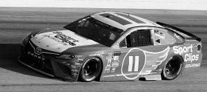 DENNY HAMLIN drives during a NASCAR Monster Cup auto race at Darlington Raceway last Sunday. Joe Gibbs Racing received fines and suspensions for post-race issues.