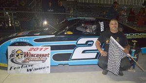 ROB GREENLEAF of West Bath poses for a photo after winning the 25-lap Kennebec Equipment Rental Outlaw Mini feature at Wiscasset Speedway on Saturday.