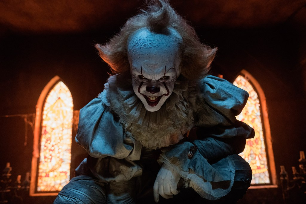 """Bill Skarsgard plays the terrifying clown Pennywise in a scene from """"It."""" He'll reprise the role in the sequel, due out in September 2019."""