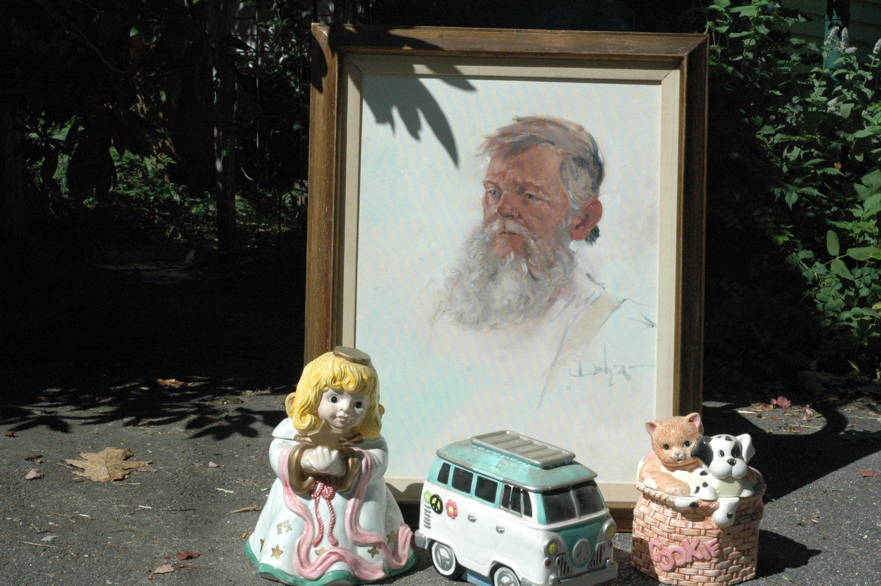 A portrait of the late John Desmond by Biddeford artist Robert Dohar and a few pieces from his collection of piggy banks and cookie jars are shown. LIZ GOTTHELF/Journal Tribune