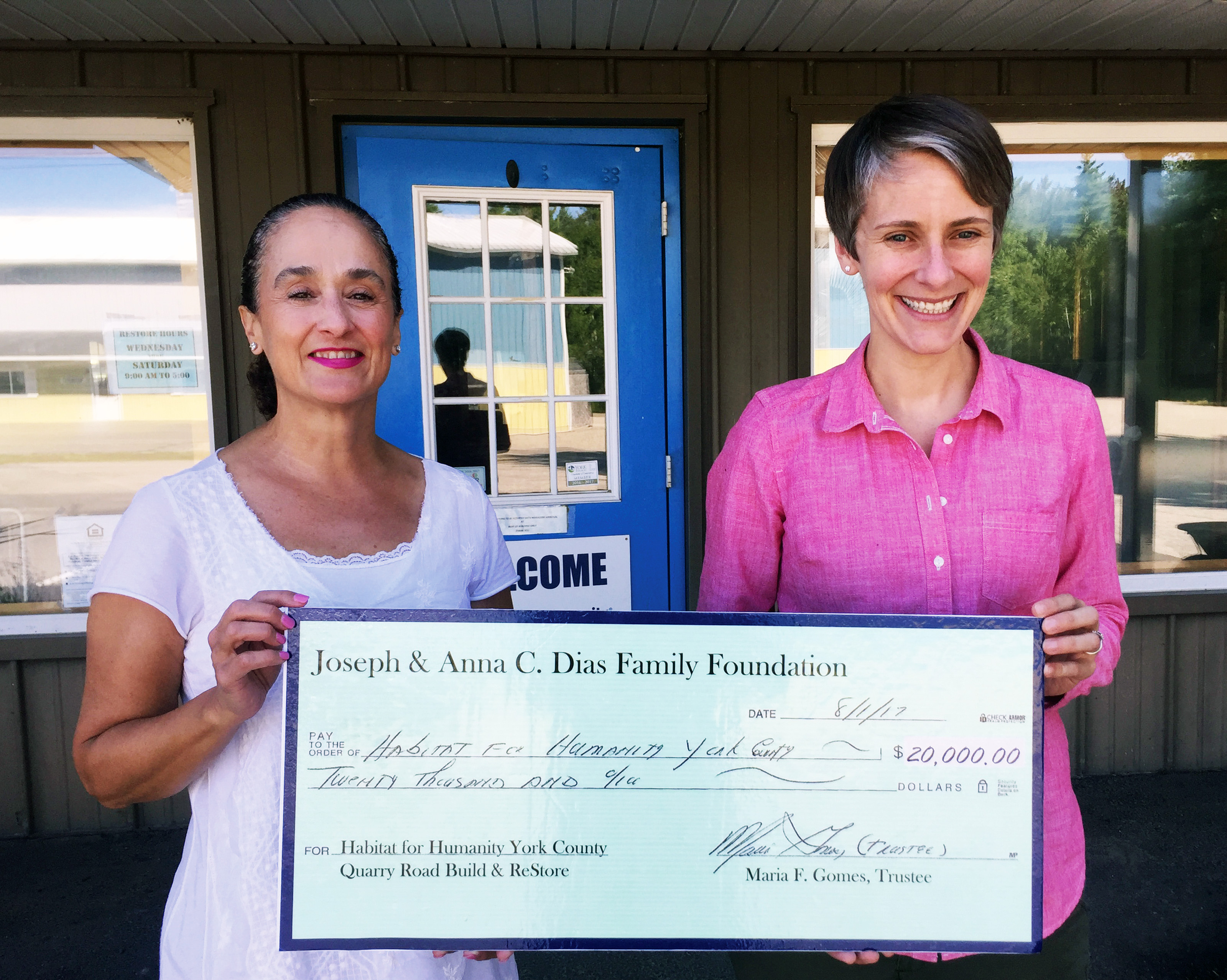 Janice Dias, left, presents a check for $20,000 to Amy D. Nucci, Habitat for Humanity of York County's Executive Director. The donation from the Joseph and Anna C. Dias Family Foundation will support Habitat's Quarry Road Build in Wells and the Habitat ReStore in Kennebunk. SUBMITTED PHOTO