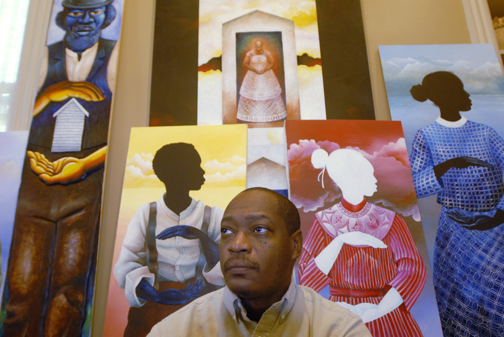 Portland artist Daniel Minter, one of the 25 artists selected for the PMA biennial, with some of his work at his Portland home.