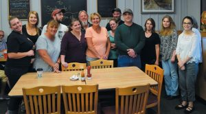 EMPLOYEES OF THE Southgate Restaurant and Kopper Kettle stand together as one family at a fish fry benefit at the Kopper Kettle in Topsham on Wednesday.