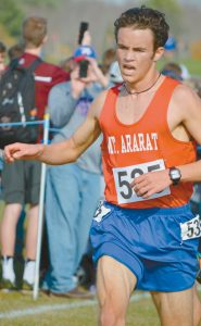 MT. ARARAT HIGH SCHOOL'S Lisandro Berry-Gaviria nears the finish line on his way to a win in the State Class A Boys Cross Country Championship at Twin Brook in Cumberland on Saturday.