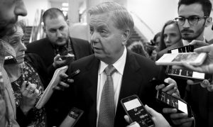 SEN. LINDSEY GRAHAM, R-S.C., chairman of the Senate Subcommittee on Crime and Terrorism, is questioned by reporters during votes, at the Capitol in Washington, Thursday.