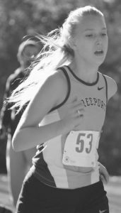 FREEPORT HIGH SCHOOL'S Elsa Blease runs in the Western Maine Conference Cross Countr y Championship at St. Joseph's College in Standish on Friday.