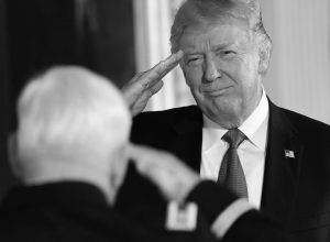 PRESIDENT DONALD TRUMP, right, salutes retired Army Capt. Gary M. Rose, left, before bestowing him with the nation's highest military honor, the Medal of Honor, during a ceremony in the East Room of the White House in Washington, Monday.