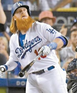 LOS ANGELES DODGERS' Justin Turner watches his two-run home run off Houston Astros starting pitcher Dallas Keuchel during the sixth inning of Game 1 of baseball's World Series Tuesday in Los Angeles. The Dodgers won, 3-1