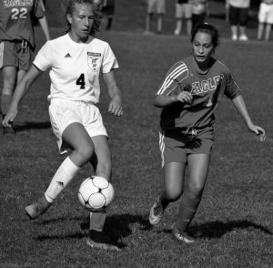 DRAGON EMMA BANKS (4) dribbles past Reece Turcotte of Mt. Ararat in a recent girls soccer game.
