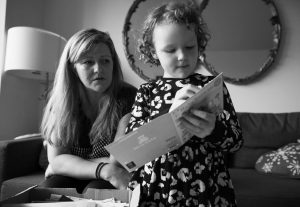 JULZ DONALD AND HER DAUGHTER, Freda Potts, 5, look through mementos from Superstorm Sandy during an interview in New York. Freda was one of 32 babies evacuated from the NYU Langone Medical Center after it got flooded and lost power during Superstorm Sandy in 2012.