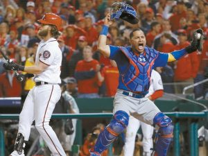 CHICAGO CUBS CATCHER Willson Contreras begins to celebrate after Washington Nationals' Bryce Harper struck out swinging in the ninth inning to end Game 5 of the National League Division Series at Nationals Park in Washington. The Cubs advanced to the NLCS with a 9-8 win.
