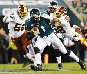 WASHINGTON LINEBACKER Junior Galette (58) grabs at the facemask of Philadelphia Eagles quarterback Carson Wentz (11) during the first half of an NFL football game on Monday in Philadelphia. Galette and the Redskins were penalized for the infraction.