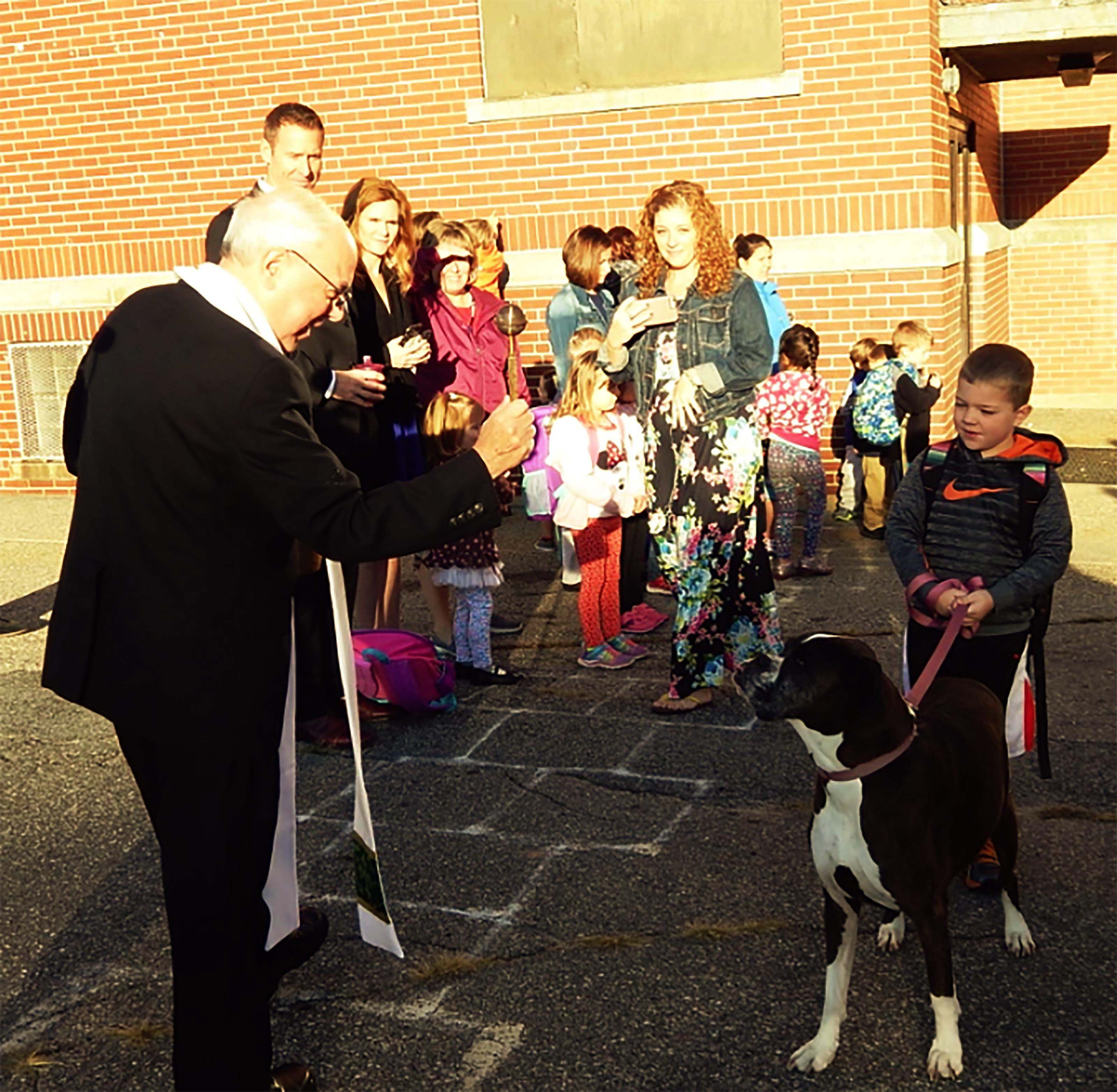 Students and family members brought their pets to St. James School in BIddeford on Wednesday morning to receive the Blessing of the Animals from the Rev. Robert Gaudreau of Good Shepherd Parish. ED PIERCE/Journal Tribune