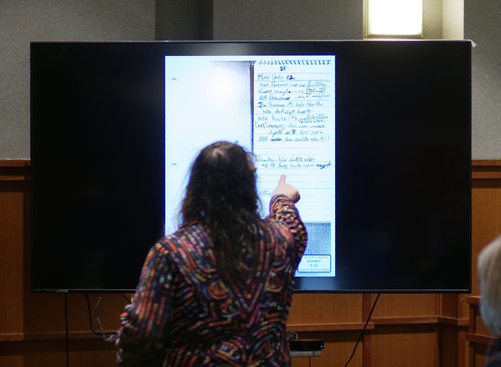 Attorney Amy Fairfield points out descriptions of people in a detective's notebook while questioning Ned Chester during the post-conviction review of Anthony Sanborn at the Cumberland County Courthouse on Monday. Chester was one of Sanborn's attorneys during his 1992 trial for murder.