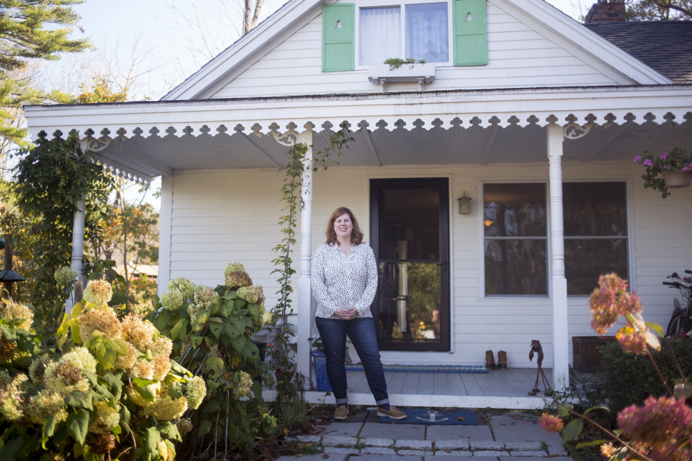 Cara Gaffney outside of the home that she and her husband bought in 2005. They later found out the home was built as a summer cottage by cookbook author Lily H. Wallace in the 1920s.