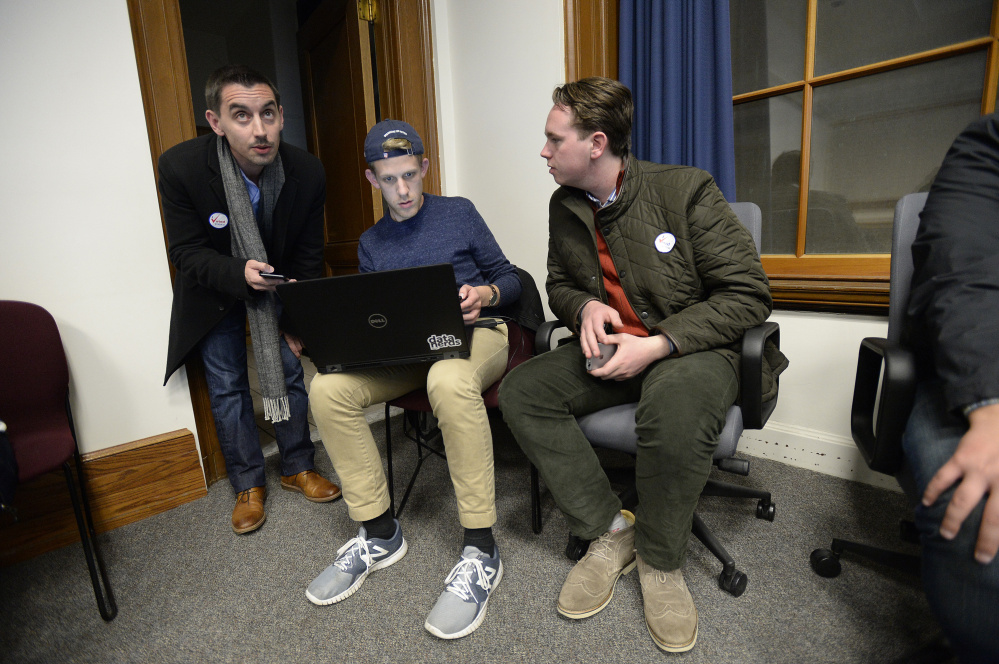 City Council District 4 candidate Justin Costa watches election results come in Tuesday at Portland's City Hall with Simon Thompson and Eamonn Dundon, who both worked with Jill Duson's campaign. (Staff photo by Shawn Patrick Ouellette/Staff Photographer)