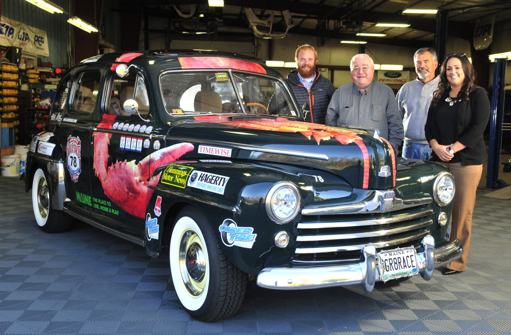 From left, Patrick Wright, Peter Prescott, Ed Chapman and Katie Doherty stand with Prescott's 1948 Ford in Gardiner. Prescott has been a fan of the Great Race for more than 20 years. Staff photo by Joe Phelan