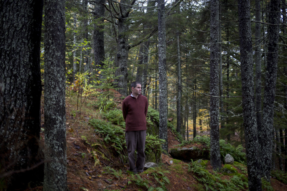 """Mark Elwin poses for a portrait near his home in Walpole. He was hospitalized for tick-borne anaplasmosis in 2015. Still unable to work, he says of his downward spiral, """"It's been devastating."""" Experts recommend wearing long clothing and checking for ticks often."""