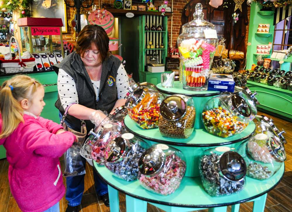 Jaylynn Tenney, 6, and her grandmother Angie Newhouse shop for candy in Scrummy Afters on Saturday on Water Street in downtown Hallowell.