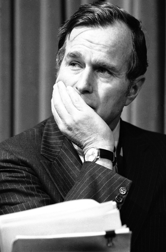 "Former President George H.W. Bush is pictured in December 1975, long before his election to the White House. ""This is hardly a sexual predator,"" says Mark Updegrove, author of a newly released book titled ""The Last Republicans,"" about the relationship between Bush and his son George W. Bush. ""This is a man who made an inappropriate gesture and a bad joke with women he didn't know well."""