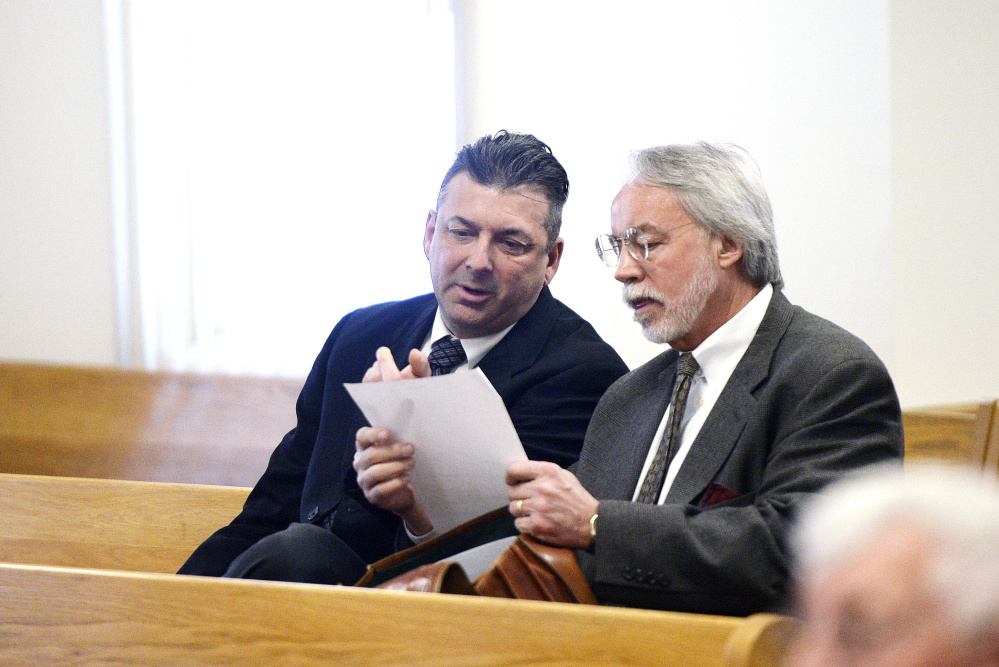 Former Ogunquit Town Manager Thomas Fortier, left, talks with attorney Bruce Merrill at a court proceeding in March. Fortier's theft trial ended Wednesday in a mistrial.