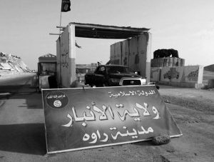 "A SIGN IS POSTED AT A CHECKPOINT belonging to the Islamic State group in 2014, captured from the Iraqi Army, at the main entrance of Rawah, 175 miles northwest of Baghdad, Iraq. Arabic reads, ""Islamic State, the Emirate of Anbar, City of Rawah."" Iraq's Defense Ministry said Friday that Iraqi forces have retaken the last IS-held town in the country, more than three years after the militant group stormed nearly a third of Iraqi territory."