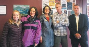 FROM LEFT, Rosie Nelson, of Sen. Susan Collins' office; Debora King, of the Brunswick Downtown Association; Gail Kezer, of Sen. Angus King's office; The Little Dog Coffee Shop owner Paul Harrison, and Mark Delisle, of the Maine Small Business Development Centers, visit retailers along Maine Street in Brunswick.