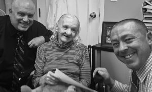 THIS OCTOBER 2017 FILE PHOTO provided by the Sullivan County Sheriff's Office shows Flora Harris, center, with Sullivan County Sheriff's Detective Sgt. Ed Clouse, left, and Detective Rich Morgan at an assisted living residence in Lowell, Massachusetts.