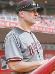 ARIZONA DIAMONDBACKS manager Torey Lovullo works in the dugout on July 20, 2017 against the Cincinnati Reds in Cincinnati. Lovullo won the National League Manager of the Year Award on Tuesday. In his first full season as a big league skipper, Arizona reached the playoffs a year after going 69-93.