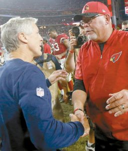 SEATTLE SEAHAWKS head coach Pete Carroll, left, and Arizona Cardinals head coach Bruce Arians shake hands after an NFL football game ended in a 6-6 tie in Glendale, Ariz. on Oct. 23, 2016. The Seahawks will be favored when they face Arizona tonight.