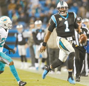 CAROLINA PANTHERS Cam Newton (1) runs past Miami Dolphins' Xavien Howard (25) in the second half of an NFL football game in Charlotte, N.C. on Monday. The Panthers won their third straight game with the 45-21 victory over the Dolphins.