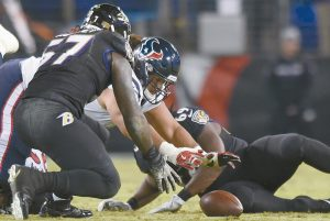 BALTIMORE RAVENS inside linebacker C.J. Mosley (57) and Houston Texans offensive guard Xavier Su'a-Filo chase after a Texans fumble in the second half of an NFL football game on Monday in Baltimore. Baltimore recovered the ball on the play and downed the Texans, 23-16.