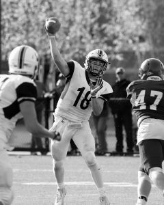 BOWDOIN COLLEGE quarterback Noah Nelson (18) delivers a pass during Saturday's NESCAC college football game at Garcelon Field in Lewiston against Bates. The host Bobcats came away with a hard-fought 24-17 victory despite 297 yards passing from Nelson.