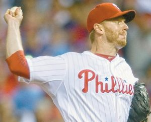 FORMER PHILADELPHIA PHILLIES pitcher Roy Halladay throws against the Cincinnati Reds during Game 1 of baseball's National League Division Series in Philadelphia on Oct. 6, 2010. The two-time Cy Young Award winner, who pitched a perfect game and a playoff no-hitter, died Tuesday when his private plane crashed into the Gulf of Mexico. He was 40.