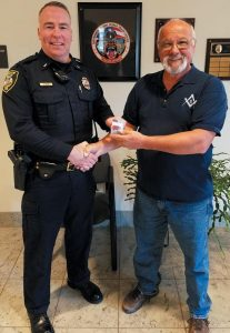 ED CARON of the Brunswick Masonic Lodge United # 8 Charities Corp presented Lt. Fred Dunn of the Topsham Police Department with 100 Hannaford gift cards, each worth $20, in an effort to foster positive community relationships. The gift cards are to be distributed by his officers while on patrol when they see a resident in need or to someone they see doing a good deed. The Brunswick Masonic Lodge United #8 implemented this program in 2016 with the Brunswick Police Department and based upon its success decided to continue this year with the Topsham Police Department Department.