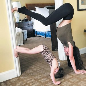 THIS PHOTO provided by Hilaria Baldwin shows Baldwin and her daughter, Carmen, doing some yoga in New York.