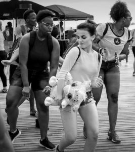 A GIRL and the stuffed animal she won dance with friends on the Coney Island boardwalk, in this photo by John Bald, who will discuss street photography in Topsham.