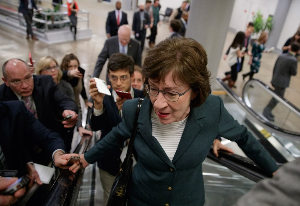 With reporters looking for updates, Sen. Susan Collins, R-Maine, and other senators rush to the chamber to vote on amendments Thursday as Republican leaders work to craft their sweeping tax bill.