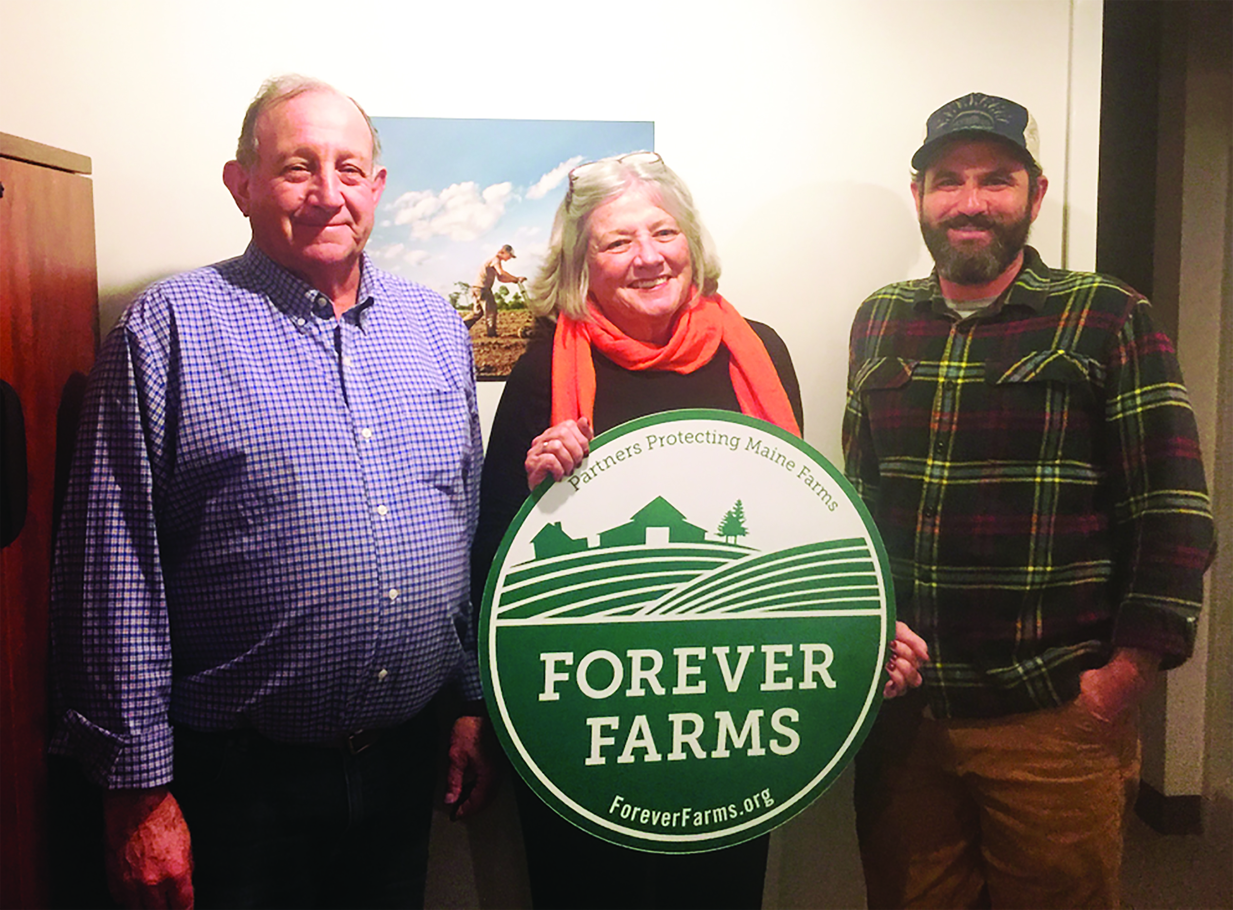 John and Martha Charest join MFT Land Protection staff member Charlie Baldwin at the closing of the donated easement for their farm in Buxton. COURTESY PHOTO/Maine Farmland Trust