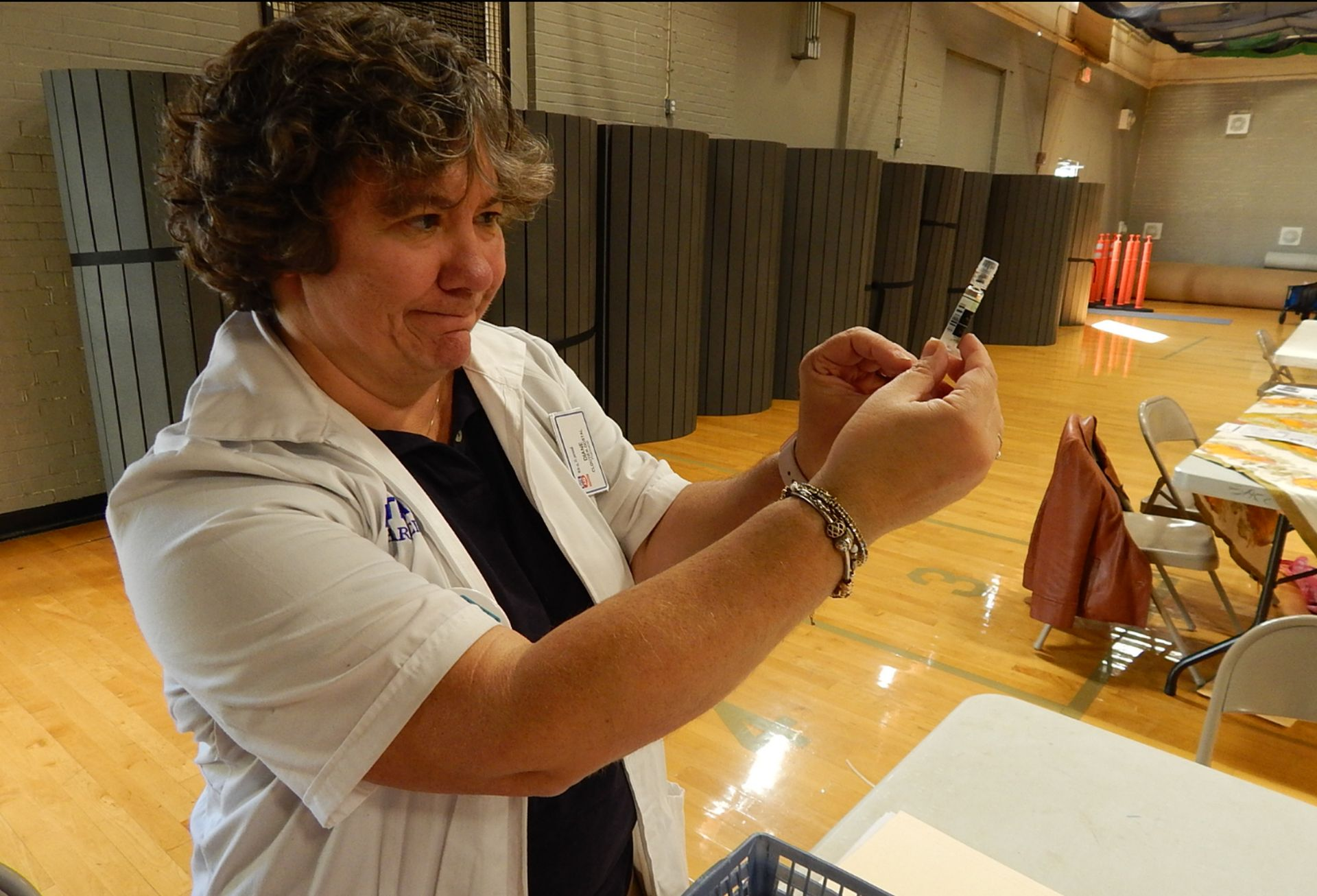 Diane Cloutier-Dostal of Rite Aid Pharmacy prepares flu vaccine for use during the Age Friendly Saco Volunteer Forum and Wellness Fair at the Saco Community Center on Saturday. ED PIERCE/Journal Tribune