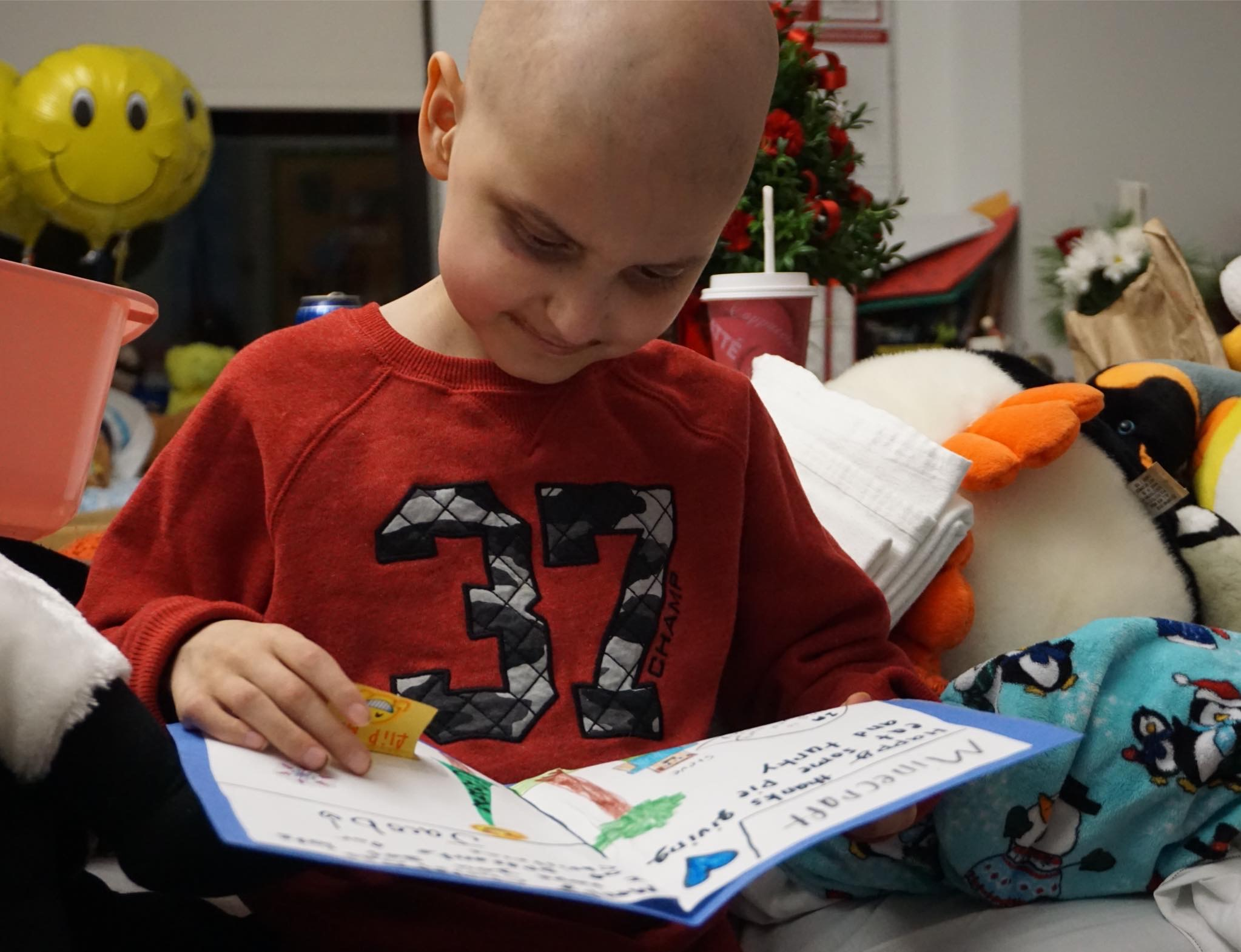 Jacob Thompson of Saco reads a Christmas card he received at Barbara Bush Children's Hospital. SUBMITTED PHOTO
