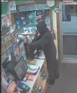 Lisbon police are asking the public to help locate the suspect captured in this surveillance video during an armed robbery Wednesday night. SUBMITTED PHOTO