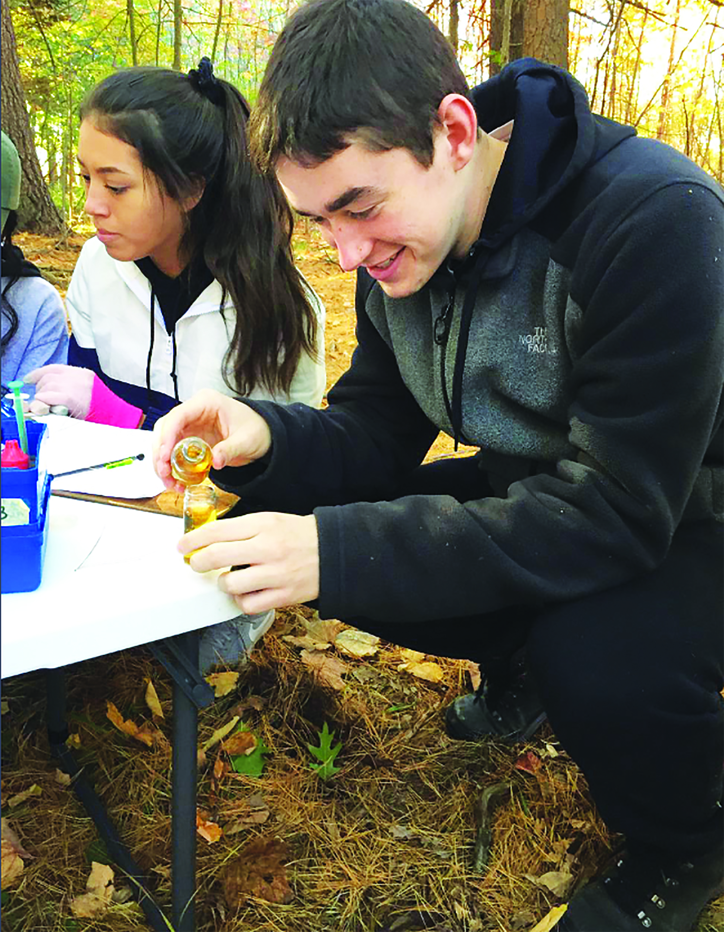 Students conduct field tests to record the dissolved oxygen of Thatcher Brook. SUBMITTED PHOTO